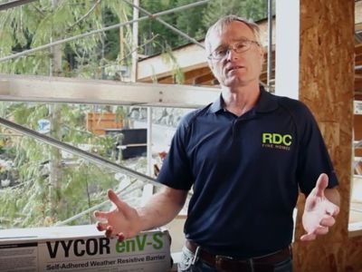 Bob describes Vycor enV-S self-adhered, breathable, waterproof housewrap. This acts similarly to traditional house wraps, but in addition makes the house air tight.